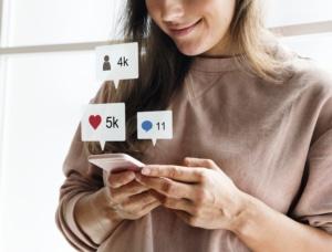 Woman using a smartphone social media