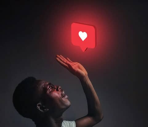 Person looking at glowing heart icon