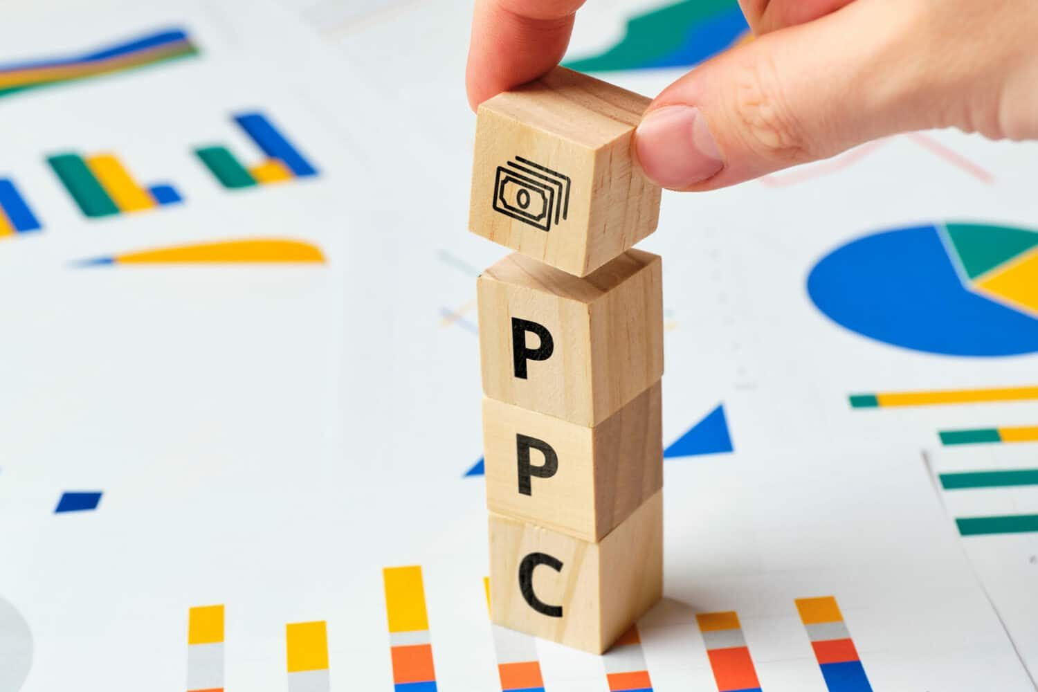 Pay per click PPC on wooden blocks with graphs